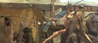 Jar Jar snagging food from a vendor in The Phantom Menace credit Lucasfilm