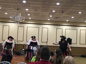Two sea going lasses confronting a pirate