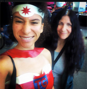 My Post Producer, Chinisha Scott cosplaying as our logo Troubled Girl and myself at NYCC.