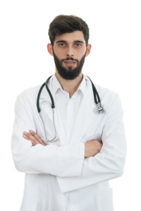Young serious handsome bearded doctor with white coat and stethoscope.